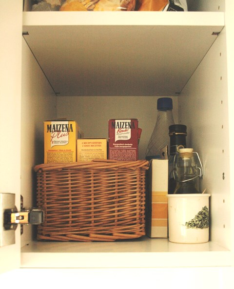Organise your kitchen - use bins to group similar items